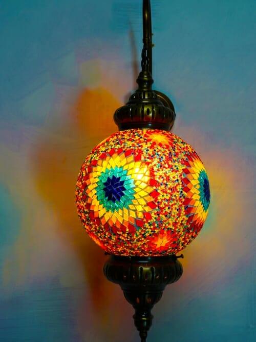 Sun multi coloured mosaic wall light