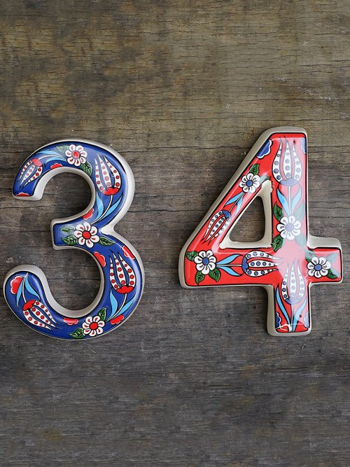 Group of coloured house numbers 34