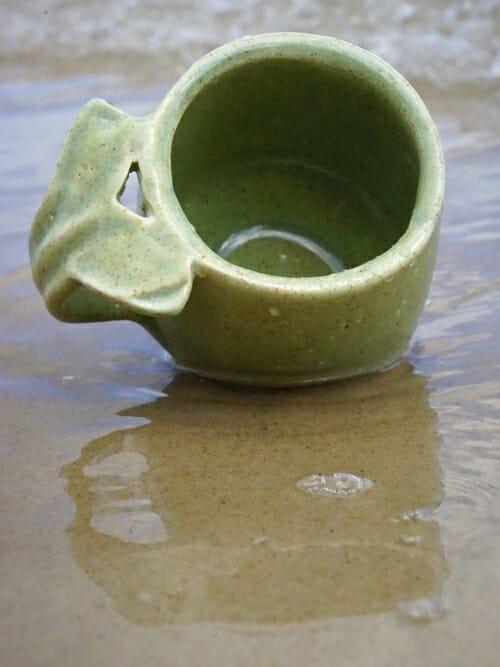 green handmade ceramic whale tail mug close up