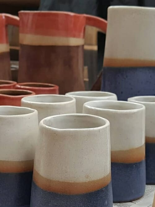 light blue ceramics water jug and 6 cUPS