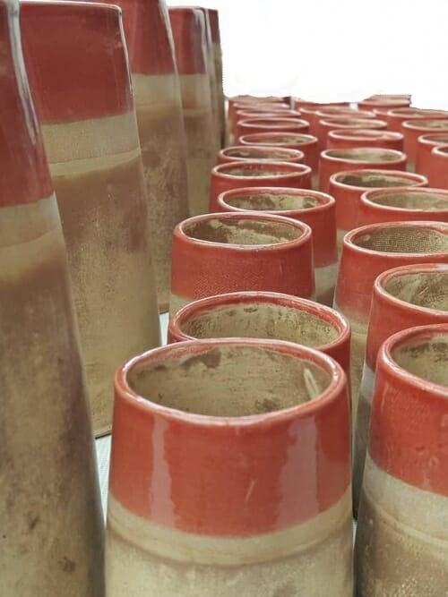 light brown ceramics water jug and 6 cups