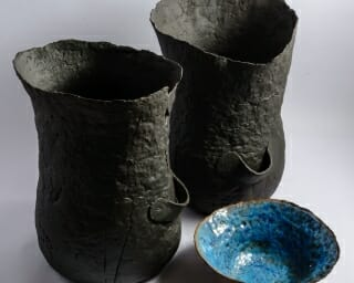 handmade ceramic sculptural vessel the bag matte black side by side with bowl