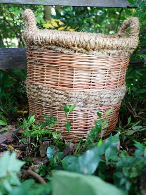 medium handmade wicker basket in trees