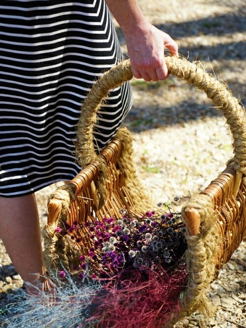 small handmade wicker basket with flowers